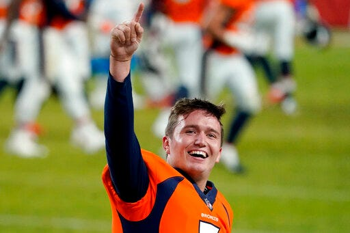 Denver quarterback Drew Lock celebrates after last week's game against the Los Angeles Chargers in Denver.  [AP photo/Jack  Dempsey]