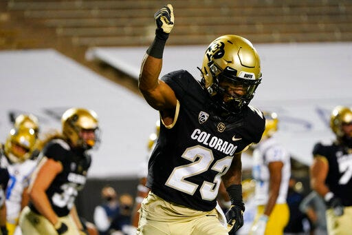 Colorado running back Jarek Broussard reacts after rushing for a touchdown against UCLA in the first half of an NCAA college football game Saturday, Nov. 7, 2020, in Boulder, Colo. (AP Photo/David Zalubowski)
