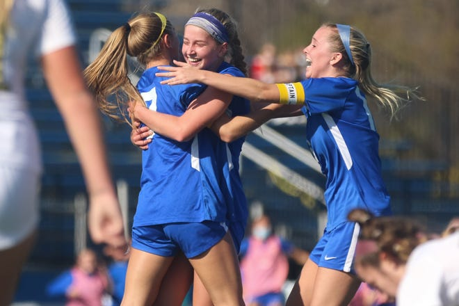 Olentangy's Kylee Beinecke, left, is congratulated by teammates Audrey Oliver and Carly Ross after scoring the game's only goal Nov. 7 against visiting Watterson as the Braves won their first Division I regional title.