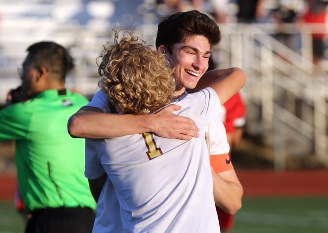 New Albany's Jakob Bering, facing, and Kameron Kist celebrate after the Eagles defeated host Thomas Worthington 2-1 on Nov. 7 in a regional final. Kist scored a goal as New Albany earned its first trip to the state tournament in Division I.