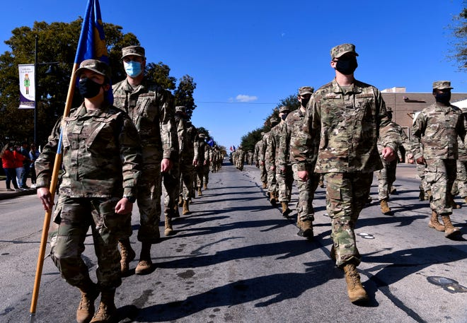 Airmen from Dyess Air Force Base march in formation during Saturday's Veterans Day parade in downtown Abilene Nov. 7, 2020.