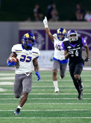 Angelo State running back Alfred Grear runs for a touchdown against Abilene Christian during last season's game at Wildcat Stadium. The Rams beat ACU 34-21 in the Nov. 7 game.