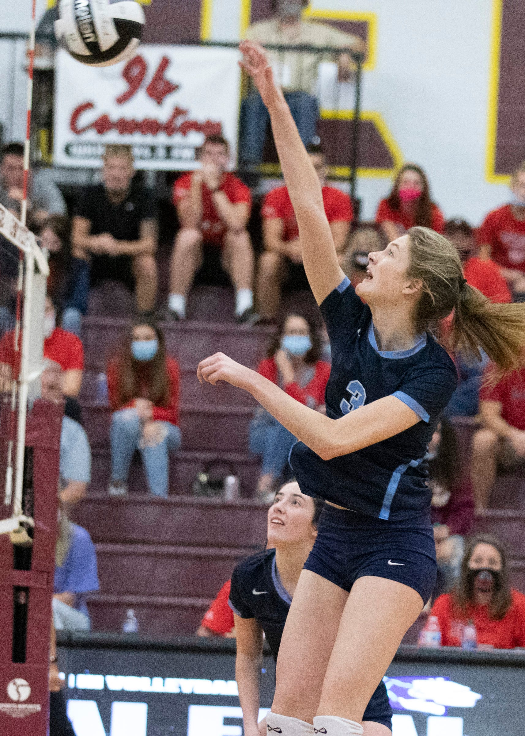 Jenna Martin returning a ball during the Adena girls volleyball team's loss to Tuscarawas Valley 3-2 in a Division III regional final at Berne Union High School in Sugar Grove, Ohio.