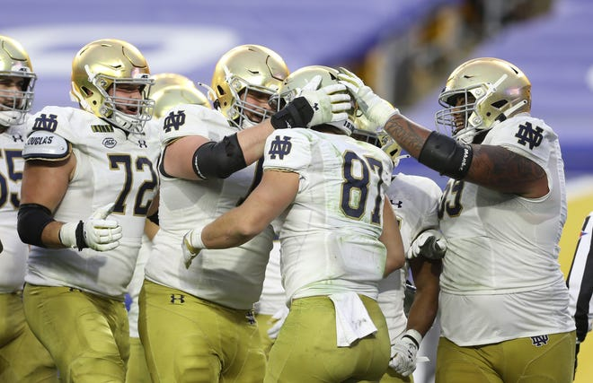 Teammates congratulate Notre Dame Fighting Irish tight end Michael Mayer (87) on his touchdown against the Pittsburgh Panthers on Oct. 24.