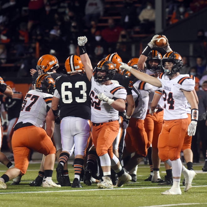 Bryce Prater (62) leads the cheers after Ridgewood's Kadin Bradford recovered a third-quarter fumble during Ridgewood's 17-7 loss to Ironton in the Division V, Region 19 championship game at Tanks Memorial Stadium.