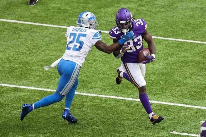 Minnesota Vikings running back Dalvin Cook runs the ball against Detroit Lions safety Will Harris during the second quarter at U.S. Bank Stadium, Nov. 8, 2020.