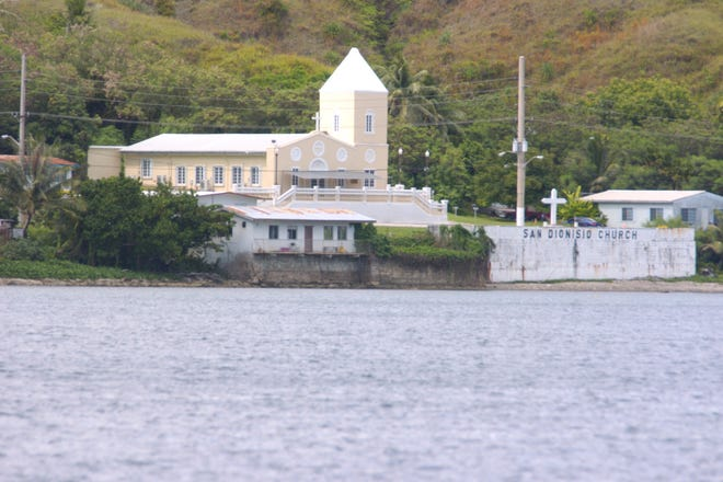 The San Dionisio Catholic church in Umatac from outside of Umatac Bay is shown in this file photo.