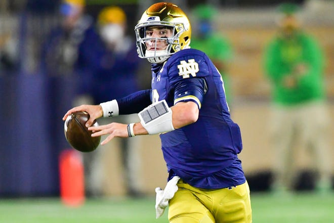 Notre Dame Fighting Irish quarterback Ian Book (12) throws in the first quarter against the Clemson Tigers at Notre Dame Stadium.