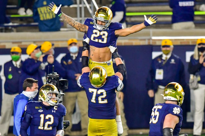 Nov 7, 2020; South Bend, Indiana, USA; Notre Dame Fighting Irish running back Kyren Williams (23) celebrates with offensive lineman Robert Hainsey (72) after a touchdown in the first overtime against the Clemson Tigers at Notre Dame Stadium. Notre Dame defeated Clemson 47-40 in two overtimes. Mandatory Credit: Matt Cashore-USA TODAY Sports