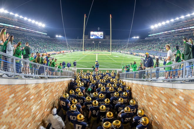 Nov 7, 2020; South Bend, Indiana, USA; The Notre Dame Fighting Irish gather in the tunnel before the game against the Clemson Tigers at Notre Dame Stadium. Notre Dame defeated Clemson 47-40 in two overtimes.