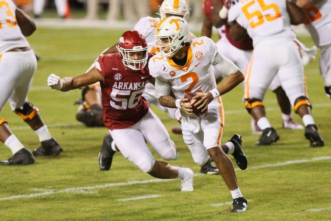 Tennessee Volunteers quarterback Jarrett Guarantano (2) runs the ball as Arkansas Razorbacks linebacker Zach Williams (56) defends in the first quarter at Donald W. Reynolds Razorback Stadium in Fayetteville, Arkansas, Nov. 7, 2020