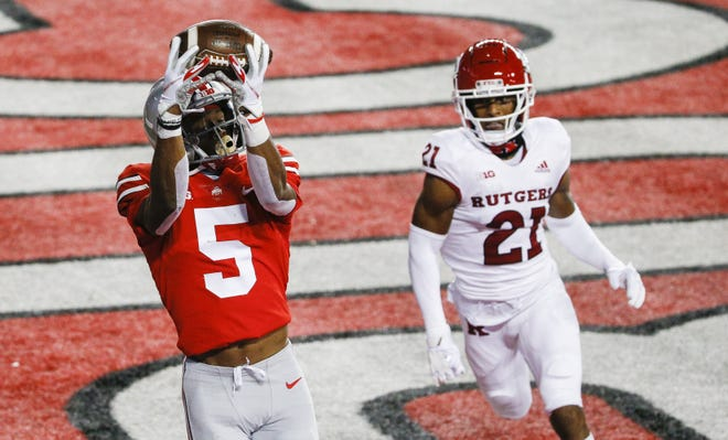 Ohio State wide receiver Garrett Wilson makes a touchdown catch in the left corner of the end zone in Saturday's 49-27 victory over Rutgers