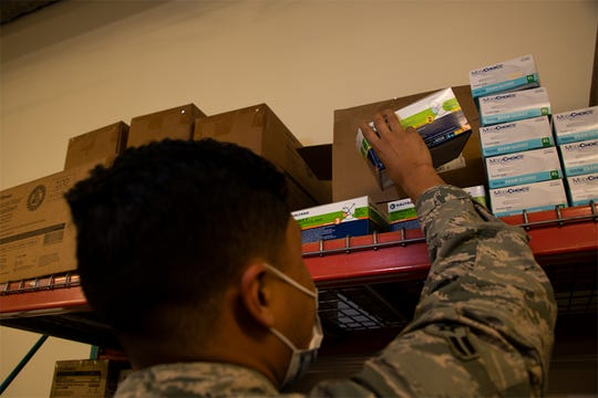 Airman 1st Class Yobanni Calderon, 42nd Medical Materiel professional, restocks personal protection equipment at the 42 MDG, November, 6, 2020. Calderon ensures availability of PPE for all MDG staff. The efforts of Calderon permit the MDG mission to continue during the current COVID-19 environment.