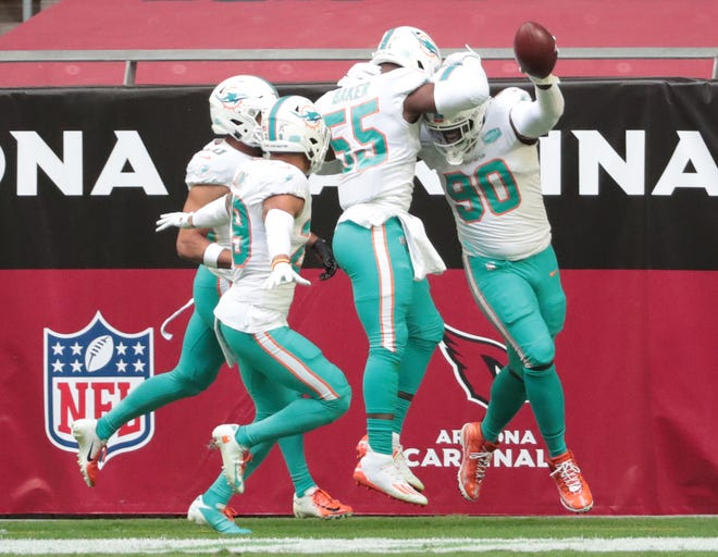 Dolphins defensive end Shaq Lawson (90) celebrates after recovering a fumble and scoring a touchdown against the Arizona Cardinals.