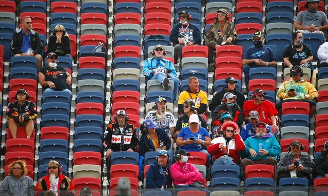 NASCAR fans watch the race from the stands during the Season Finale 500 at Phoenix Raceway in Phoenix, Ariz. on Nov. 8, 2020.