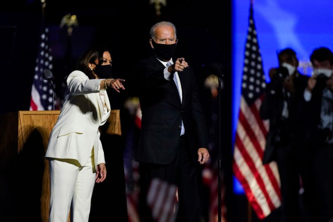 President-elect Joe Biden and Vice President-elect Kamala Harris stand on the stage Saturday, Nov. 7, 2020, in Wilmington, Del.