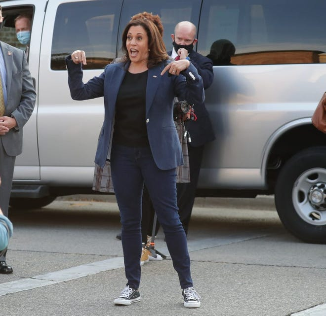 Democratic vice presidential candidate Kamala Harris smiles as she briefly took her mask off to address a crowd of supporters to vote, while leaving JCP Construction, on North Martin Luther King Drive in Milwaukee on Monday. Harris paid a visit to Milwaukee Sept. 7 to talk to business owners and union members.