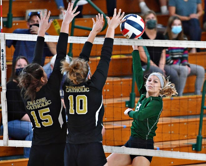 York Catholic's Hope Leavy-Gaskins, right, seen here in a file photo, had 11 kills and 21 digs on Tuesday night against Trinity.