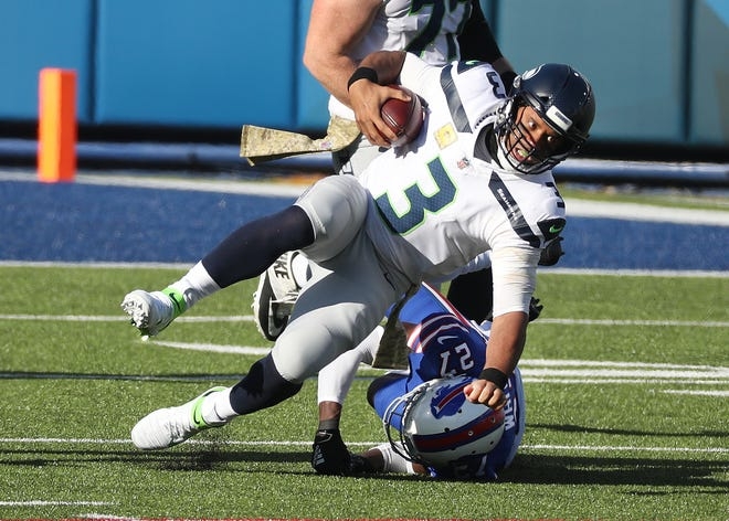 Seahawks quarterback Russell Wilson is caught from behind by Bills Tre'Davious White.