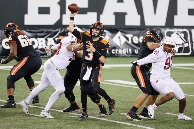 Oregon State Beavers quarterback Tristan Gebbia (3) throws a pass while under pressure from Washington State Cougars defensive lineman Dallas Hobbs (98) during the first half at Reser Stadium in Corvallis on Nov. 7, 2020.