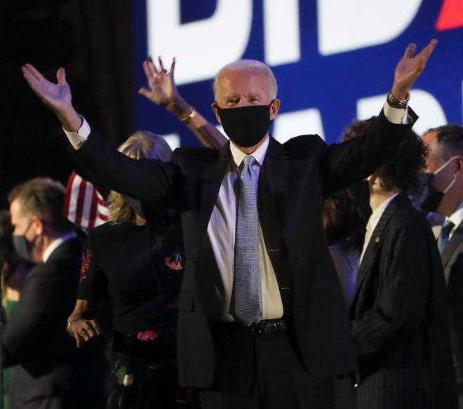 Joe Biden celebrates his election to the presidency after a victory speech outside the Chase Center on Riverfront Saturday evening.
