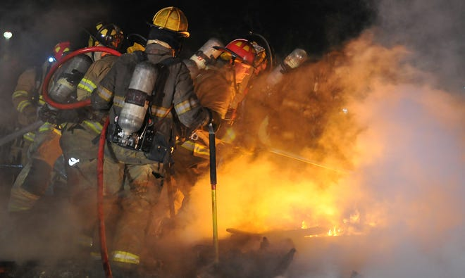 Wichita Falls firefighters work to control an early Sunday morning structure fire on East Fort Worth Street.