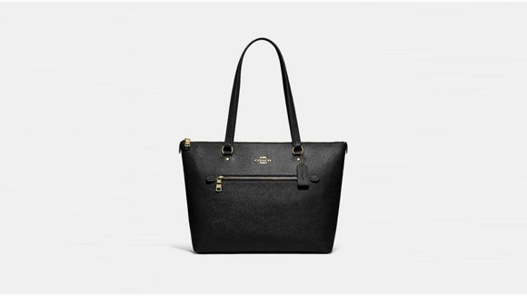 This tote features internal and external storage.