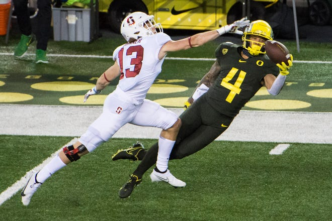 Oregon wide receiver Mycah Pittman catches a pass against the Stanford Cardinal during the first half at Autzen Stadium.