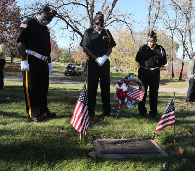 American Legion John Fulton Post 272 members, from left, Lonnie Deck, Robert Cuellas and Joseph Campbell pay their respects Monday at a graveside tribute to Civil War veteran Alvin Smith.