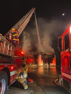 A fire destroyed a concrete business in the 5500 block of Old Easton Road in Plumstead Sunday.