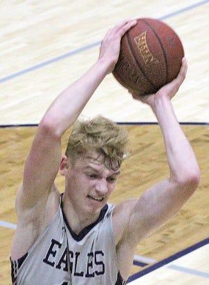 Kaleb Stokes hauls down a rebound for the Oklahoma Wesleyan University men's team.