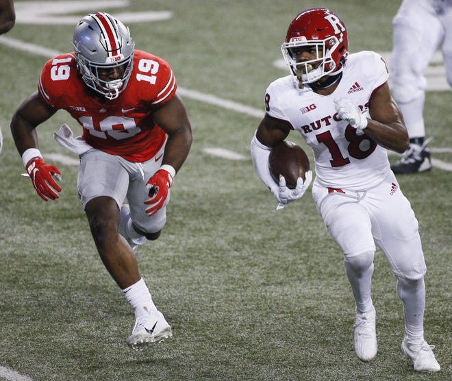 Rutgers receiver Bo Melton was a tough target to tackle for linebacker Dallas Gant (19) and the rest of the Ohio State defense.