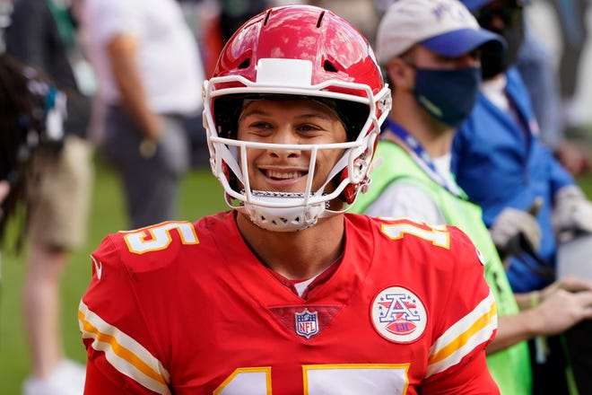Kansas City Chiefs quarterback Patrick Mahomes (15) smiles during the second half of an NFL football game against the Carolina Panthers in Kansas City.
