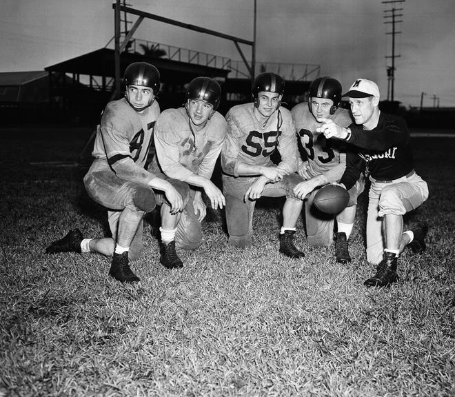 The probable backfield lineup of the University of Missouri for their game against Maryland in the Gator Bowl on Jan. 2, 1949 in Jacksonville, Florida, get some last minute instructions from their coach Don Faurot, right. From left to right: Phil Klein, Dick Brazwell, John Gloriosco and Win Carter.
