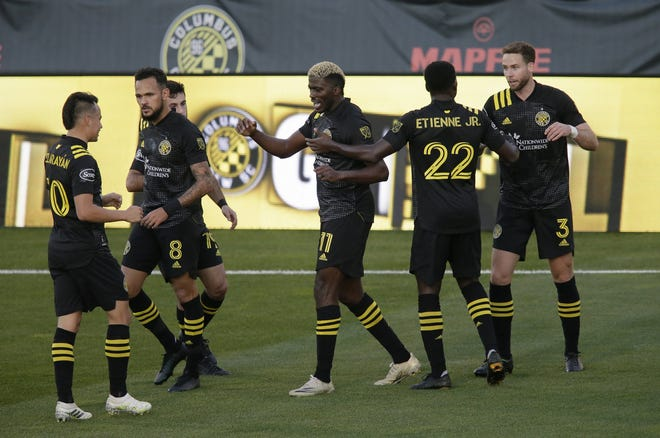 Crew forward Gyasi Zardes (11) celebrates with teammates after he scored for a 2-0 lead over Atlanta United in the 55th minute on Sunday in Mapfre Stadium.