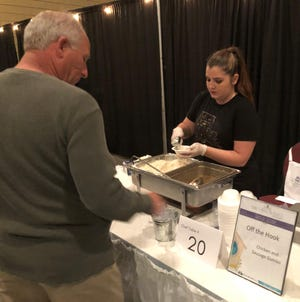 Rachel Faye of Off The Hook serves up a bowl of gumbo at the Home is Where the Heart Is gala fundraiser for The Haven at the Houma-Terrebonne Civic Center on March 30, 2019. This year's fundraiser had to be canceled because of the COVID-19 pandemic.