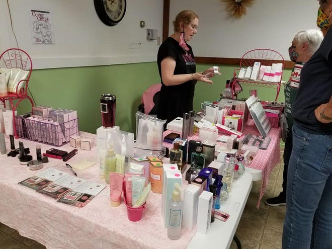 Shown here is Mary Kay vendor Elaine Metzger discussing products with shoppers.
