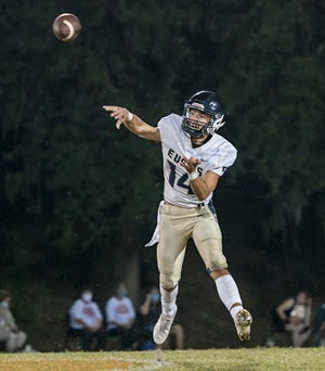 Eustis quarterback Blayne Romano (14) throws for some of his career high 458 yards Friday against Mount Dora in a Class 4A-Region 2 Play-In game at Mount Dora. Despite Romano's effort, Mount Dora edged the Panthers 47-44. [PAUL RYAN / CORRESPONDENT]