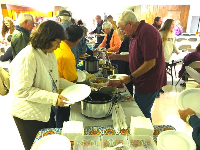 The tables almost sag beneath a bounty of delicious, homemade church supper fare during the 2018 Laurel Hill Harvest Supper.