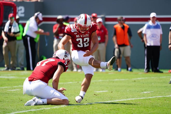 North Carolina State's Christopher Dunn, shown in this file picture kicking a field goal against East Carolina, made field goals of 42 and 53 yards in the Wolfpack's 44-41 loss to Miami on Saturday.