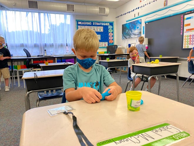 First-grader Gabriel McCleary wore a mask on the first day of school at Greencastle-Antrim Primary School. The district is asking everyone to wear a mask rather than a face shield.