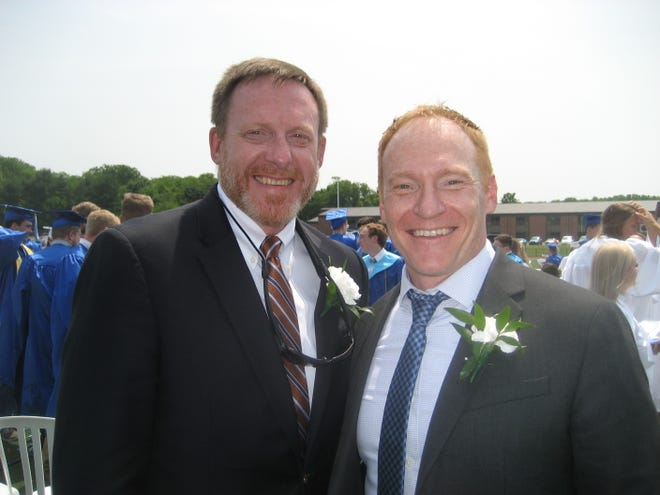 The Greencastle-Antrim School Board is accepting applications to fill the vacancy created by the resignation of Mike Still, right, shown at graduation in 2019 with the speaker, retired Adm. Mike Rogers.