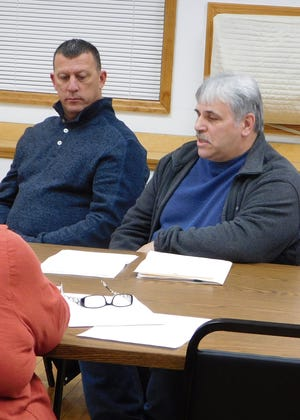 Mike Irons, left, who has been named superintendent of utilities for the village of Frankfort, is shown here with Power and Light Foreman Joe Salvaggio during a village board meeting earlier this year.