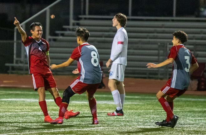 Van Horn senior forward Edison Rios, left, celebrates with teammates Tony Chavira (8) and Daniel Aguilar (3) after scoring in the second half of Saturday's Class 3 sectional playoff against Harrisonville. Van Horn won 2-0 to advance to Tuesday's state quarterfinal against Pembroke Hill.