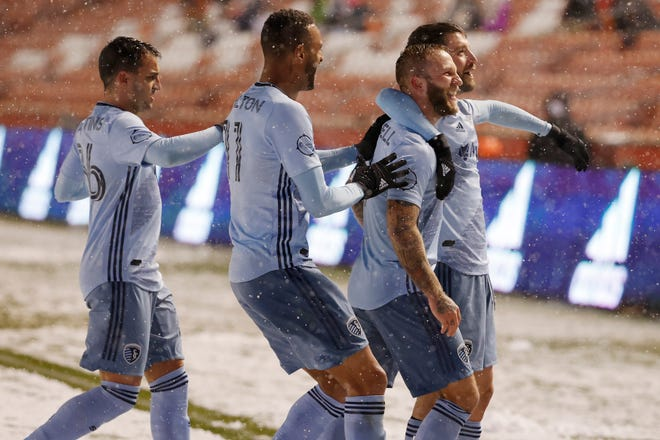 Sporting Kansas City forward Erik Hurtado, right, celebrates with teammates Johnny Russell, Khirey Shelton and Luis Martins, right to left, after scoring a second half goal in a 2-0 victory over host Real Salt Lake in the snow Sunday.