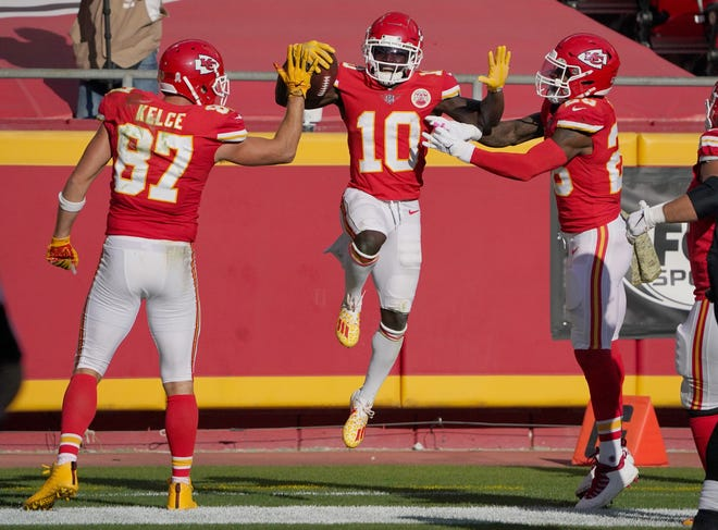 Kansas City Chiefs wide receiver Tyreek Hill (10) celebrates with tight end Travis Kelce (87) and running back Le'Veon Bell after scoring against the Carolina Panthers during the second half of Sunday's game at Arrowhead Stadium.  Hill scored two touchdowns to help the Chiefs hold on for a 33-31 victory.