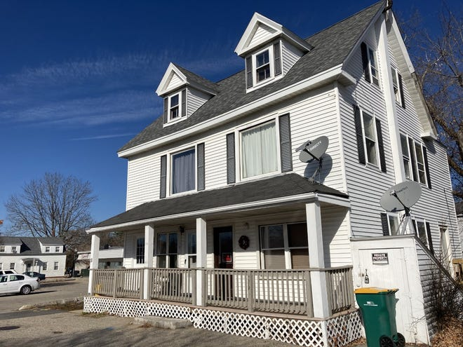 Rochester City Council approved purchasing Tuesday this white, four-unit residential building at 11 Barker Court next to the Union Street municipal parking lot for $290,000. The city proposed the purchase as part of plans to improve the key downtown lot.
