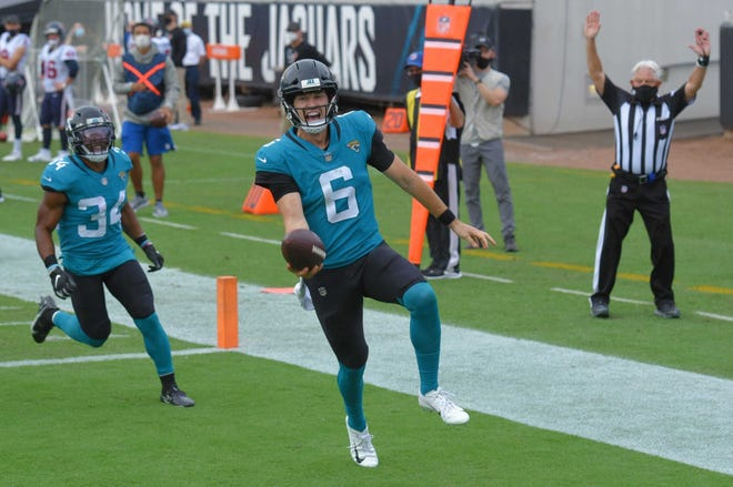 Jaguars quarterback Jake Luton (6) celebrates as he scrambles into the end zone late in the game for a touchdown in Sunday's loss to Houston.