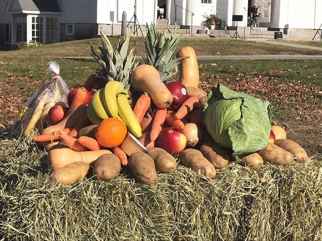 These are fruits and vegetables collected for needy families during the outdoor service at the Congregational Church of Phillipston.