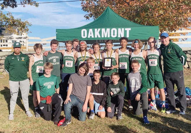 The 2019 Oakmont boys' cross country team celebrates its Mid-Wach C League championship victory at Hollis HIlls Farm in Fitchburg last year. This year's team had nine runners returning from last year's title team. Front row (left-to-right): Nick Goodchild, Sean St. Cyr, Marty Steucek, Colby Gouldrup, Henry Telecki, and Jayden Downing. Back row (left-to-right): Coach Tim Caouette, Seth Louden, Declan LeClair, Aidan Tamulen, Kam Law, Sean Kelly, Adam Wong, Logan Tamulen, Dylan Banda, Josh Krawczyk, Tim Marsh, and Coach Ken Jepson.